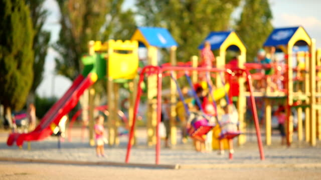 children playing in the playground - defocus children playing in the playground - defocus outdoor play equipment stock videos & royalty-free footage