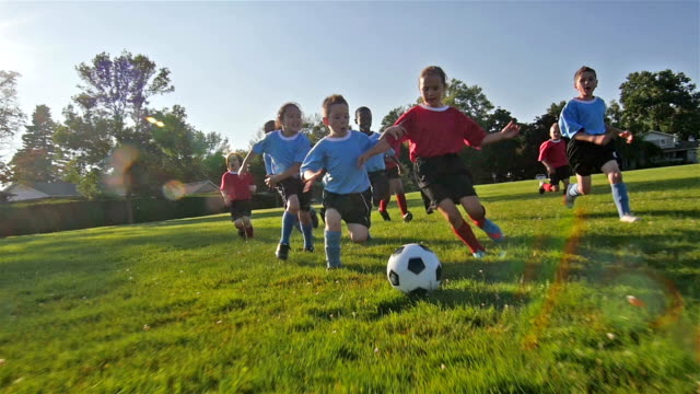 Children playing soccer video
