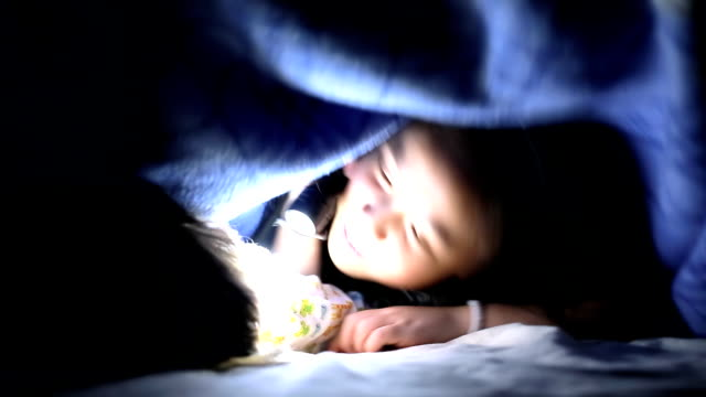 Children playing under the blanket video