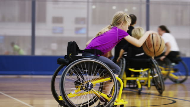 Children Playing Wheelchair Basketball Wheelchair basketball players on the court. disability stock videos & royalty-free footage