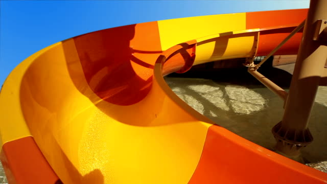 Children ride the roller coaster in the pool video