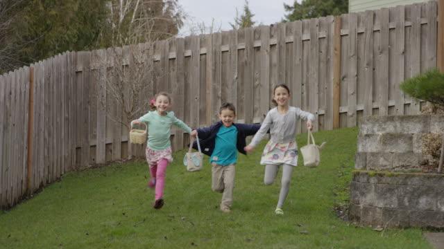 Children searching for Easter eggs video