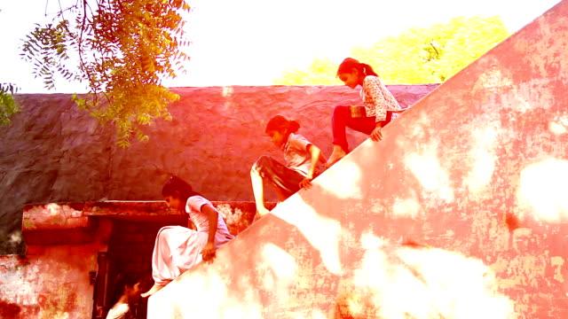 Children sliding on wall video