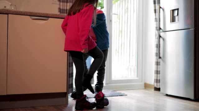 Children Taking Shoes Off Children coming home from a long walk outside with the dogs. medium group of people stock videos & royalty-free footage