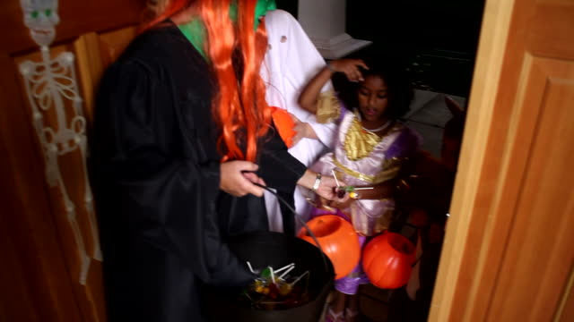 Children trick or treating  candy stock videos & royalty-free footage
