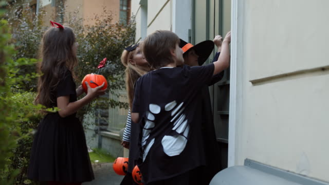 Children Trick-or-treating on Halloween Night