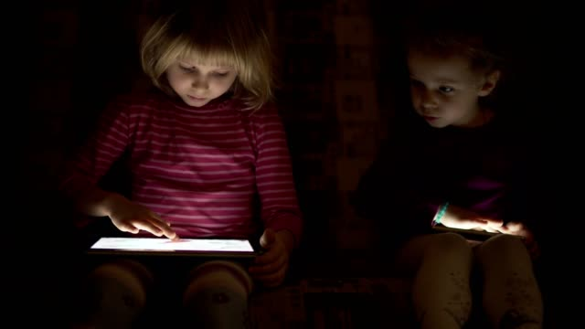 Children use the mobile phone at night. video