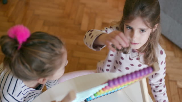 Children using abacus, slow motion, handheld shot, high angle view video