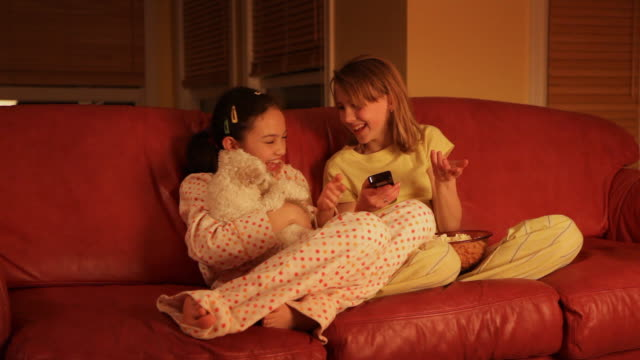 Children watching television with pet  dog video