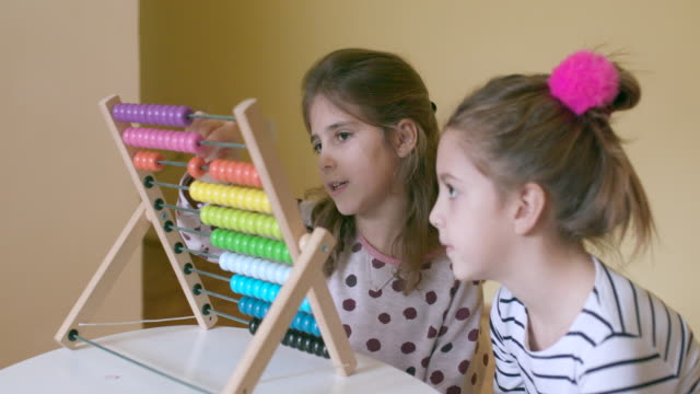 Children with abacus, handheld shot video