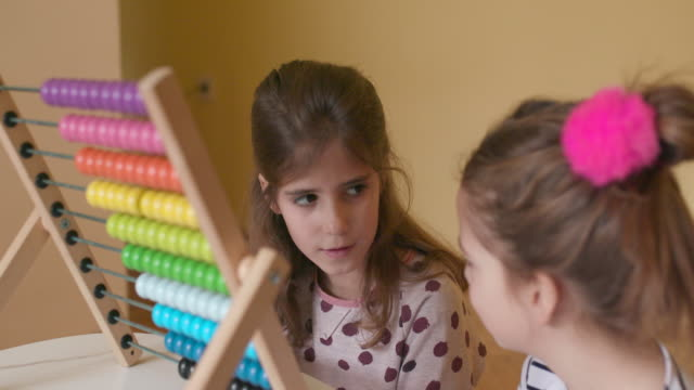 Children with abacus, slow motion video