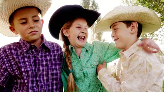children with cowboy hats - cowboy video stock e b–roll