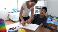 istock Children with disabilities learning better with parents. 1203234975