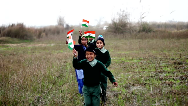Children with Indian flag in the nature