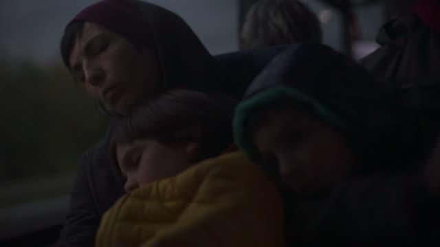 Children with mom sleep in a night bus.