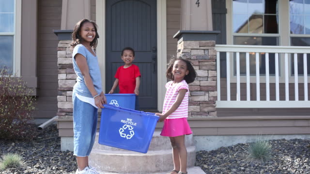 Children with recycle bins video