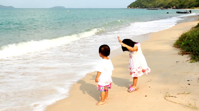 Childrens play on the beach. video