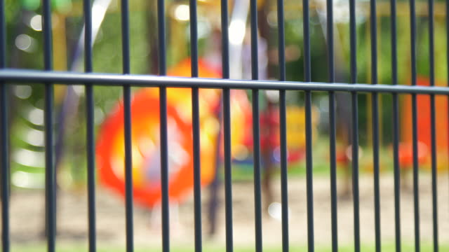 children's playground unfocus and fence - район стоковые видео и кадры b-roll