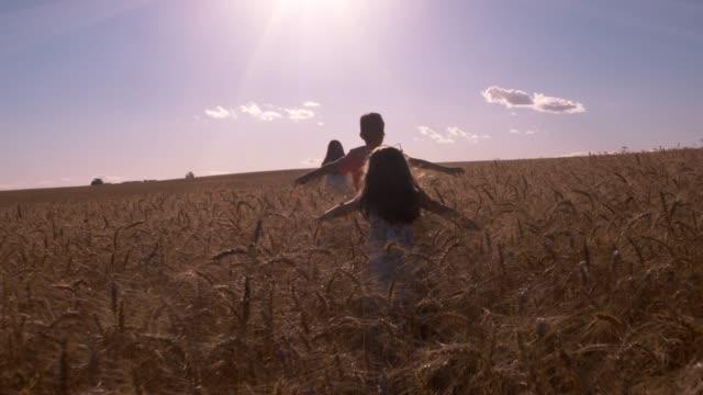 Childrens Running In Wheat
