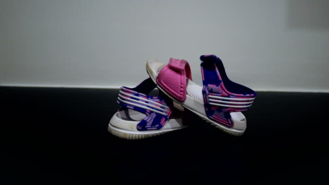 Children's shoes Dolly camera:Baby shoes for baby's first steps. baby booties stock videos & royalty-free footage