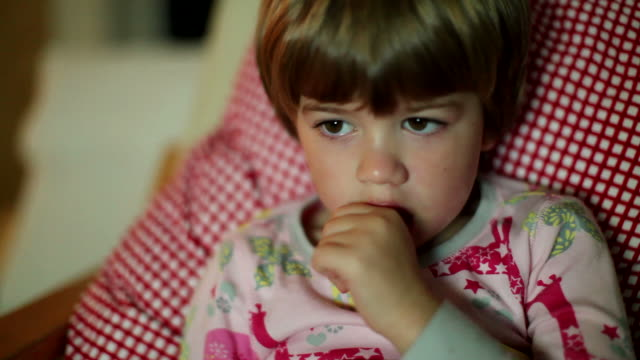 HD: Children's Television: Child Illuminated by Glow from Watching TV video