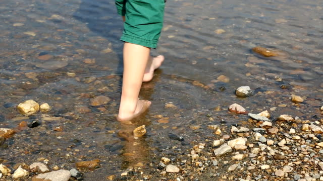 Child's feet in water video