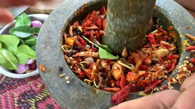 chilli mixing a raw material in a mortar chilli mixing a raw material in a mortar mortar and pestle stock videos & royalty-free footage