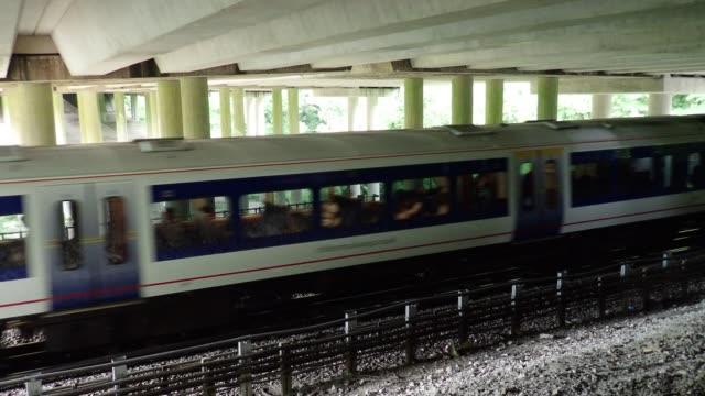 Chiltern Railways train passing underneath M25 Motorway bridge, Chorleywood, Hertfordshire video