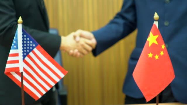çin ve amerika işbirliği kavramı - amerika kıtası stok videoları ve detay görüntü çekimi