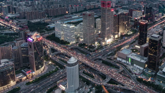 T/L WS HA PAN China, Beijing, Aerial View of Busy Intersection, Day to Night Transition, with Rush Hour Traffic video