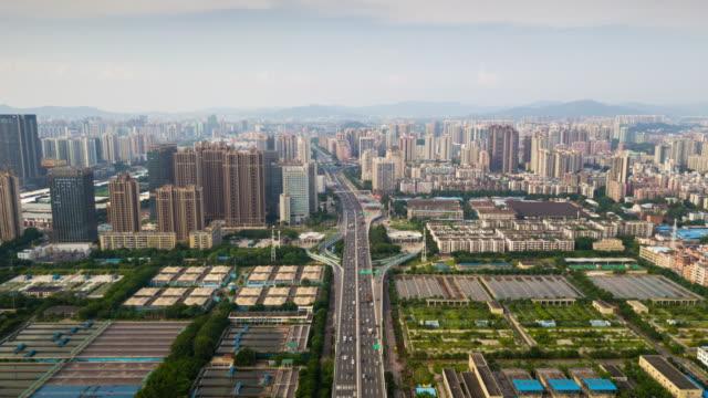 中国日時間広州産業都市の景観空中パノラマ 4 k タイムラプス - 広東省点の映像素材/bロール