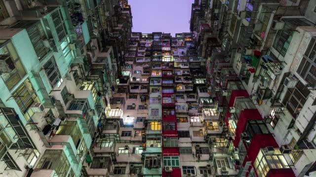 中国ハング香港都市生活マンション 4 k の夜まで時間の経過 - 香港点の映像素材/bロール