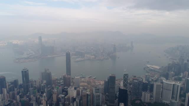 china hong kong city bay kowloon aerial morning fog sunrise panorama 4k video