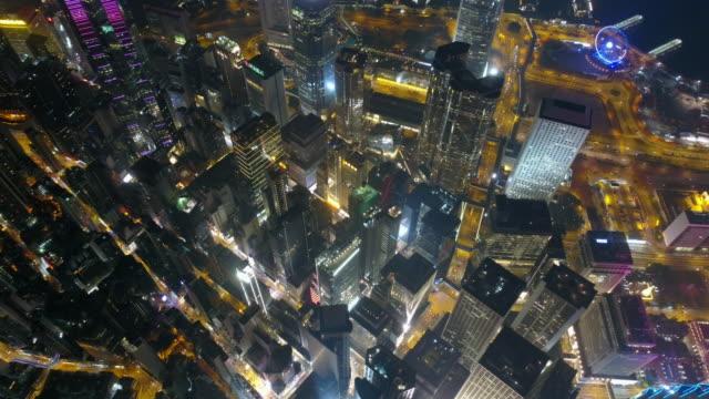 la Chine nuit illuminée hong kong ville du centre bay aérienne bas panorama 4k - Vidéo