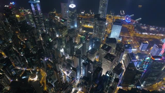 éclairé de nuit de Chine hong kong du centre Baie aerial panorama de la ville 4k - Vidéo