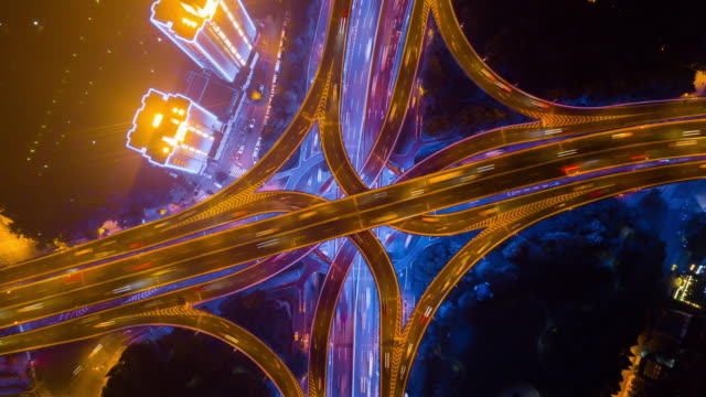 china night illuminated shanghai city famous traffic road junction down view aerial panorama 4k time lapse night shanghai city traffic road junction aerial panorama 4k timelapse china traffic time lapse stock videos & royalty-free footage