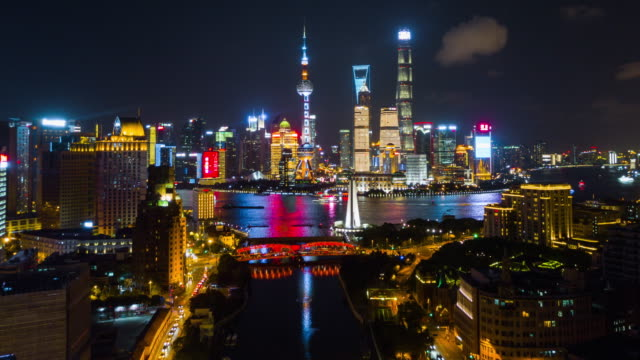 china night illuminated shanghai pudong cityscape wusong river aerial panorama 4k time lapse night shanghai pudong cityscape wusong river aerial panorama 4k timelapse china shanghai stock videos & royalty-free footage