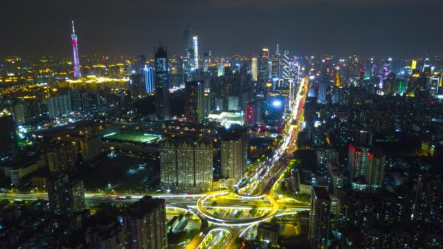 中国夜の時間点灯して広州都市の景観交通道路ジャンクション ダウンタウン空中パノラマ 4 k タイムラプス - 中国 広州市点の映像素材/bロール