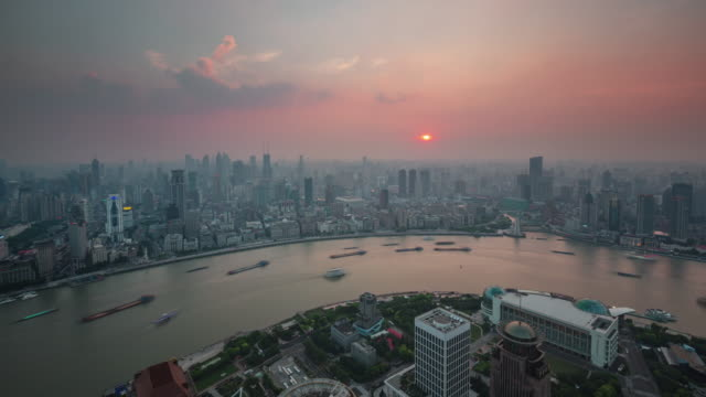china shanghai city sunset traffic cargo river bay roof top panorama 4k time lapse video