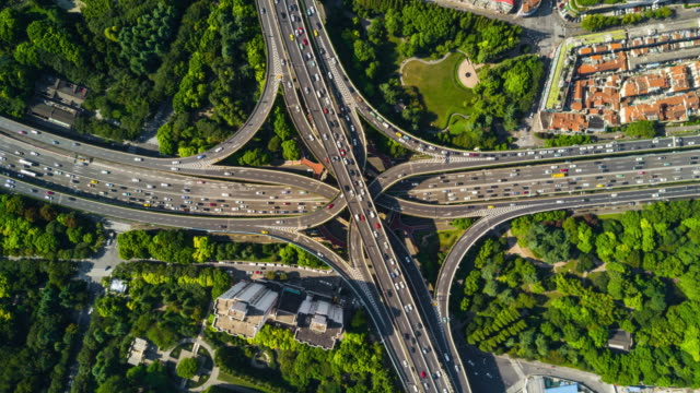china sunny day shanghai cityscape famous traffic road junction aerial panorama 4k time lapse sunny day shanghai traffic road junction aerial panorama 4k timelapse china traffic time lapse stock videos & royalty-free footage