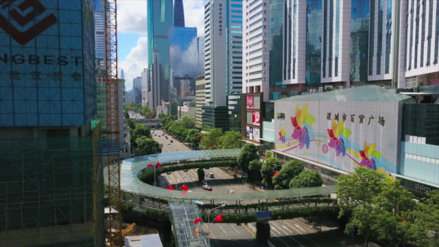 china sunny day shenzhen city traffic road pedestrian bridge mall front aerial panorama 4k - шэньчжэнь стоковые видео и кадры b-roll