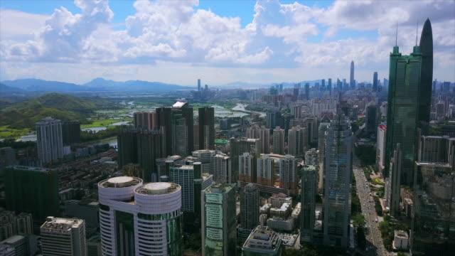 中国晴れた日の深セン都市景観ダウンタウンのトラフィックの道路空中パノラマ 4 k - 広東省点の映像素材/bロール