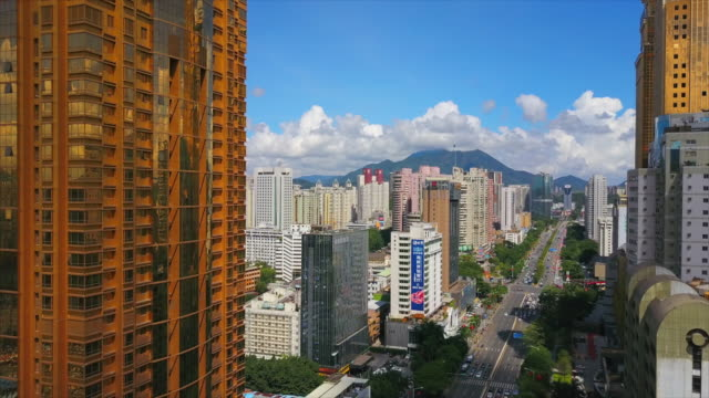 china sunny day shenzhen cityscape golden building traffic road aerial panorama 4k - шэньчжэнь стоковые видео и кадры b-roll