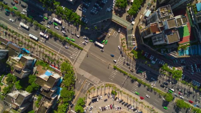china sunny day zhuhai city center traffic street crossroad aerial down view 4k timelapse - zhuhai video stock e b–roll