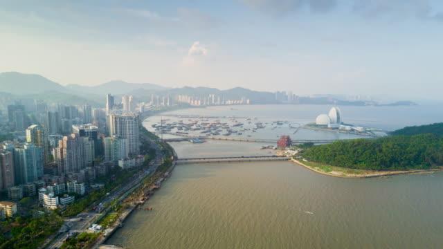 china sunny day zhuhai cityscape bay opera house island aerial panorama 4k time lapse - zhuhai video stock e b–roll