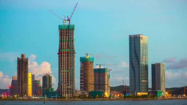 china sunny sunset zhuhai bay macau city hotels construction coastline panorama 4k timelapse - zhuhai video stock e b–roll