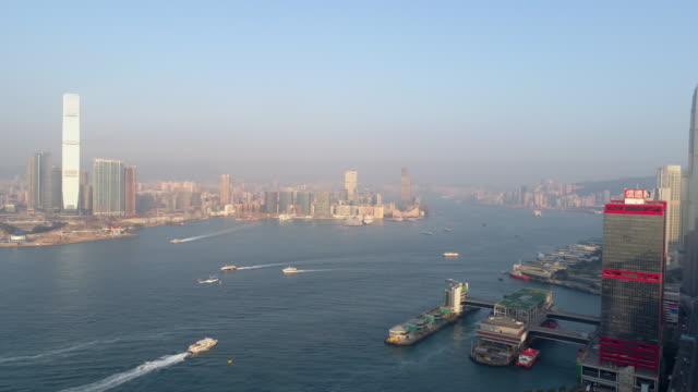 china sunset light hong kong city victoria harbour traffic aerial panorama 4k video