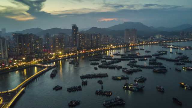 china sunset night illuminated zhuhai city bay famous port dock  aerial panorama 4k time lapse - zhuhai video stock e b–roll