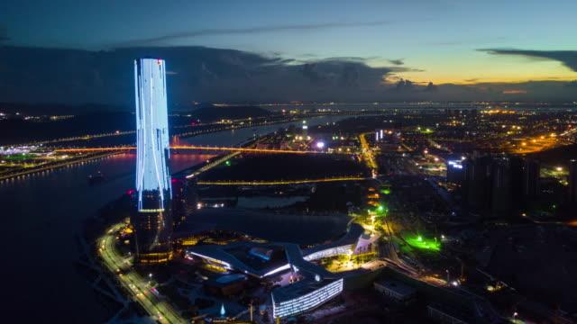 china sunset night sky illuminated zhuhai international convention and exhibition center bay aerial panorama 4k time lapse - zhuhai video stock e b–roll