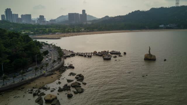 china sunset time zhuhai city famous fisher girl monument bay aerial panorama 4k time lapse - zhuhai video stock e b–roll